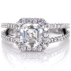 This stunning diamond engagement ring has a micro pave split shank band and a micro pave halo. The asscher cut center diamond is held in place with a double prong setting. Design 2451 from Knox Jewelers