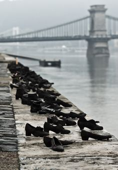 This is such a striking image I had to find out more about it. Shoes on the Danube Promenade - A row of 60 pairs of bronze shoes that look suddenly abandoned. The memorial was created by sculptor Gyula Pauer to commemorate those who were shot to...