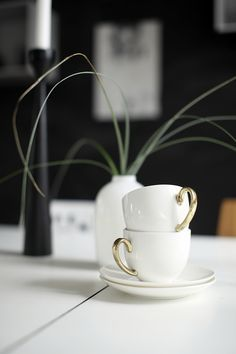 Porcelain cups, black walls