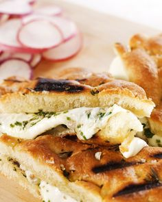 Combine softened butter with chopped anchovies, lemon zest, parsley, and chives to spread on these toasty pressed mozzarella sandwiches inspired by a traditional Italian appetizer. This recipe is courtesy of Sean Rembold from Marlow and Sons restaurant in Brooklyn, New York.
