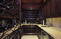 A wine cellar made for the most extensive collection, this custom room features both storage and a prep area, great for hosting a tasting. 5252 Amestoy Ave | Encino