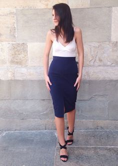 This navy pencil skirt sculpts your figure and instantly refines your look. Pair it with a white tank and black strappy heels à la Minodora Sirbu | Banana Republic