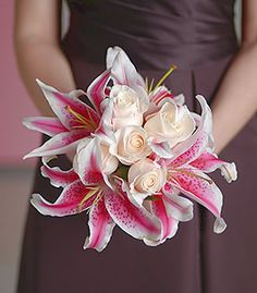 Classic cream roses paired with color bursting stargazer lilies combine for a perfect balance of chic sophistication.