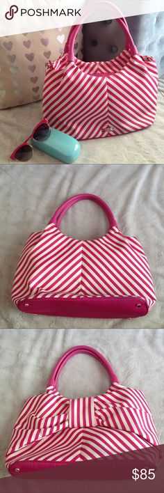 """Kate Spade Seaside Stripe Sutton Bow Bag Adorable Sutton handbag by Kate Spade. Seaside Stripe print. Pink & white striped purse with a built-in bow. Durable woven nylon with smooth leather trim. Gold plated hardware. Custom woven Quick and Curious lining. Over the shoulder with zip top closure. Interior zip and double size pockets. 6"""" drop length. See photos for measurements. Great condition, only flaw is some denim transfer near and on the bottom that can likely be cleaned (not really…"""
