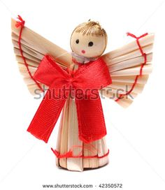 Handmade christmas decoration angel from straw, traditional Czech souvenir, isolated on white by Kletr, via ShutterStock