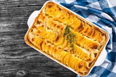 au gratin dauphinois potatoes baked in a baking dish with butter and cream authentic recipe top view close-up Potatoes Au Gratin, Sliced Potatoes, Potatoes Dauphinoise, British Cheese, Sunday Brunch, Casserole Dishes, Potato Casserole, Coconut Milk, Pavlova