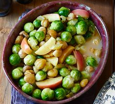 Spruce up your sprouts with pan-fried apples and sweet, melting chestnuts to give this classic Christmas side dish a delicious French twist Vegan Recipes Videos, Bbc Good Food Recipes, Vegan Recipes Easy, Vegetarian Recipes, Christmas Side Dishes, Christmas Dinner Menu, Christmas Lunch, Christmas Stuff, Navidad