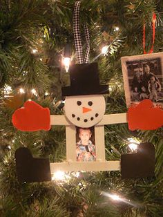 snowman out of white Popsicle sticks and craft foam or construction paper