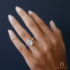 LUNA design engagement ring with two tones of metal and an Oval Cut diamond center stone.