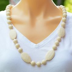 Cream silicone teething necklace, from our Tranquil Bubbles range. Pearl Necklace, Beaded Necklace, Necklaces, Gifts For Mum, Great Gifts, Teething Necklace, Bubbles, Range, Pearls