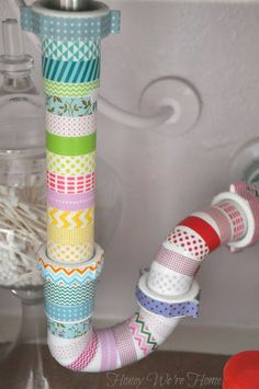 Pretty up the ugly pipe under your sink with washi tape in minutes