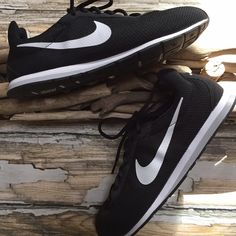 Nike Knit Sneakers.  Black Size 9.5 Nike Running Sneakers.  Size 9.5.  Black with White Accent.  Knit.  Laces with Suede Trim.  Lightweight.  Excellent Condition.  Worn maybe 2x. Nike Shoes Sneakers