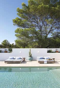 A modern Mediterranean-style holiday beach house has come to life with the guiding light of its creative owners in Ibiza. Best Picture For beach house decor For Your Taste You are looking for somethin Elle Decor, Villas, Built In Sofa, South Wales, Alicante, Mediterranean Style Homes, Art Deco Home, Blue Tiles, Australian Homes