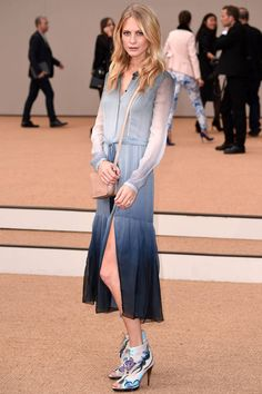 Poppy Delevingne in Burberry at the show's front row. See more front row guests here: