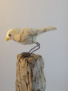 Curious little bird of handmade paper with straw and by marmoss