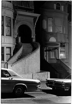 William Gedney - Houses at night with steps up to front door; cars parked out front (1960's)