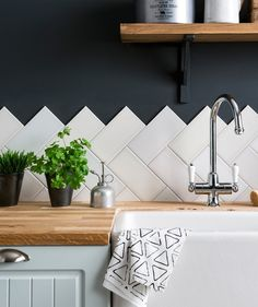 staggered finish backsplash tile is just 2 layers of subway tile in a herringbone or chevron pattern.
