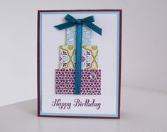 Fun birthday card using the Stampin Up  Sycamore Street designer series paper, ribbon and button pack!