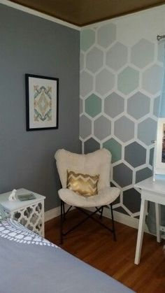grey walls and once accent wall with different shades of red, and black and grey in hexagon shapes