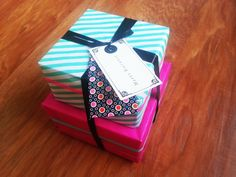 Birthday present gift. Mint striped wrapping paper with fabric and paper label, washi tape. Fabric from: Studio Saartje (http://www.studiosaartje.nl)