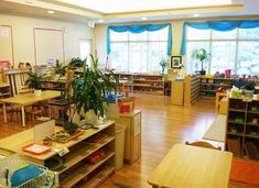 Beautiful Montessori Classroom. Love how there is wood everywhere and it is so well organized. There was obviously a lot of care and thought put into such a wonderful Montessori classroom.