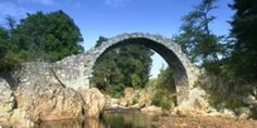 Cairngorms National Park http://cairngorms.co.uk/ Has some scenic routes and the park includes some towns.