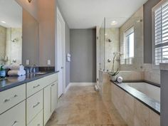 Quartz counters, walk-in shower and large bathtub 1504 Collier St.