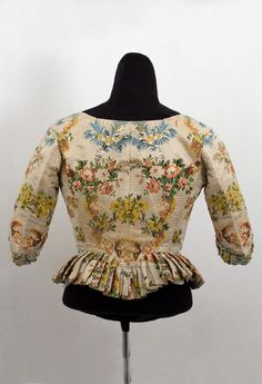 "Brocaded silk caraco-style jacket, c.1780. The center-back seam is boned. It measures: 35"" bust, 26"" waist, 15 1/2"" center-back and center-front length, and 14"" sleeve length."