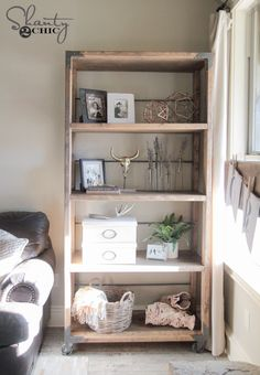 DIY Industrial Cart Bookcase [Use tips to makeover current bookshelf; add wheels and hardware.]