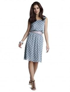 The cheery nature of large dots is met with a sporty silhouette. Below the elastic waist, the sheer skirt floats over an opaque lining. Layer it with a sweater now, and wear it all summer long. Thelimited.com