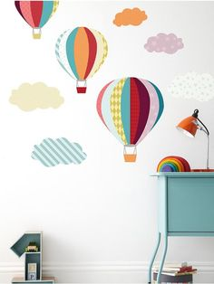 Beautiful, fun and colourful. These hot air balloon and cloud wall stickers feature quirky prints that will brighten up any room and give it a perfect finishing touch.