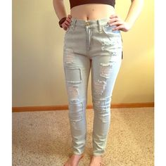 NWT 7 for all Mankind Brand new pair of high-waisted light wash jeans with patchwork and rips on the front. Size 26. Inseam 28 inches. 98% cotton 2% spandex. 7 for all Mankind Jeans