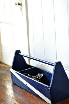 This old carpenter's toolbox makes a charming, door-side storage caddy for a place to kick off dirty shoes. A built-in divider is a great place for gloves and hats