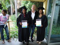 Two graduates proudly showing their GetOn certificates. On their way to employment!  GetOn Graduation November 2013