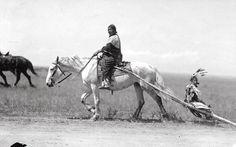 Native American woman on horseback pulling a child in the travois behind her. Early 1900s? Source - University of Wyoming, American Heritage Center.