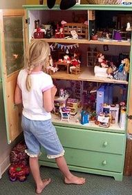 What what , I love this and I know my girls would too!  Such a wonderful repurpose!  Repurposed armoir!  Dollhouse!