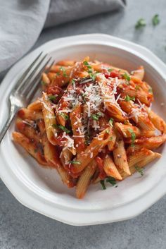 Penne Arrabbiata is anItalian pasta dish with penne noodles in a spicy tomato based sauce with fresh parmesan, basil and parsley thats made in just 20 minutes.