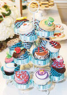 Modern & Chic Alice in Wonderland Birthday Party:Wonderland cupcakes with the Cheshire Cat, Tweedle Dee & Tweedle Dum