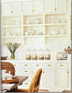 gorgeous butlers pantry done up in all white with open storage, #subwaytile, brass hardware