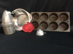 LOT INCLUDES A MUFFIN/CUPCAKE PAN, A 3X9 INCH HANDLED MIXING BOWL, A MINIATURE FUNNEL (SLIGHTLY BENT), A TURKEY COOKIE CUTTER AND A KIDDIE CREAM KING WHIPPER MOD. 1