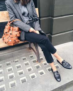 horse bit loafers, open weave leather tote, gray layers.