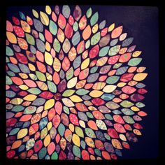 DIY artwork! Mod podge project on a black canvas with scrapbook paper leaves