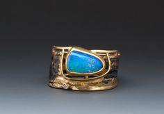 Marne Ryan Designs Boulder opal ring  Boulder Opal set in 22k Bezel in a fused band of 24k , 22k, 18k gold Price: $3,600.00