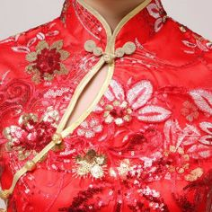chinese dress close up. there is a small slit/hole showing leaf sized slit.