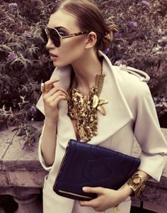 I love the texture and busy design of the necklace contrasted against a clean, tailored jacket.