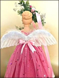 Here we have a pretty Blonde Pink Christmas Angel Tree Topper. This beauty is dressed in a sparkly deep pink gown that has an overskirt of heavy pink tulle that is covered in pink flowered sequins. She is a pink beauty with a twist of a woodland rustic flavor. Her pretty face is Ghost Of Christmas Past, Pink Christmas, Christmas Angels, Blonde With Pink, Pink Gowns, Pink Tulle, Tree Toppers, Pretty Face, Gnomes