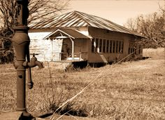 Old schoolhouse and well found near Low Gap, Arkansas.