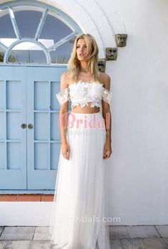 Pretty wedding dress designed in two pieces, off-the-shoulder floral lace bodice, layered tulle floor length A-line skirt.