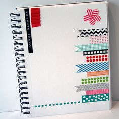 Keep a file/journal to corral ideas & inspiration for scrapbooking.  I love the washi tape deco on this one =)