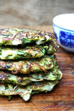 zucchini fritters with tzatziki. Getting rid of the moisture is a REALLY IMPORTANT STEP or the fritters will fall apart. And we used the leftover fritters as zucchini hash browns the next morning! Think Food, I Love Food, Good Food, Yummy Food, Tasty, Vegetable Recipes, Vegetarian Recipes, Cooking Recipes, Healthy Recipes